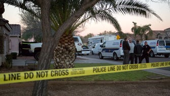 Phoenix police officers investigate on Feb. 21, 2017, the shooting deaths of a man and woman that occurred late Feb. 20, 2017. There was no indication when the scene would be cleared or the status of the four children that were on scene.