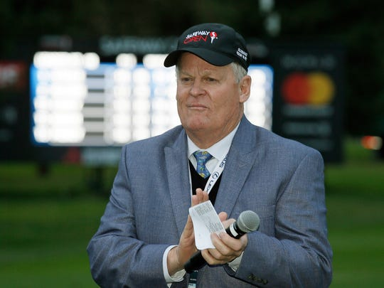 FILE - In this Oct. 16, 2016, file photo, Johnny Miller stands on the 18th green of the Silverado Resort North Course during the trophy presentation of the Safeway Open PGA golf tournament, in Napa, Calif. NBC Sports is hiring Paul Azinger as its lead golf analyst with hopes he can deliver his own brand of sharp, candid observations that made Johnny Miller such a strong presence in the broadcast booth for three decades. (AP Photo/Eric Risberg, File)