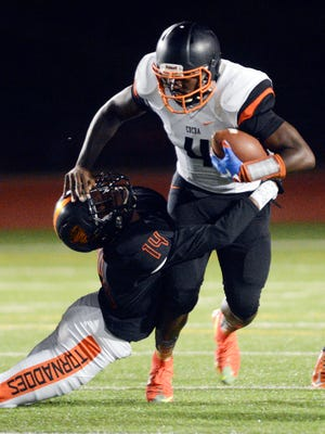 Cocoa QB Bruce Judson fights off a Booker T. Washington player last year in Miami.