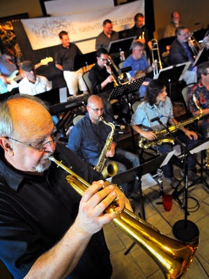 Jim Williamson plays his horn along with the Nashville Jazz Orchestra as they play at the Commodore Grille.