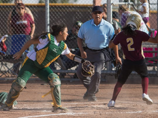 Mayfield catcher Alexandria Garibay is late on the