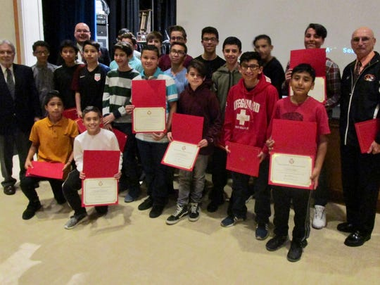 The Linden middle school boys soccer team holding Certificates of Recognition from the Board of Education for finishing their season undefeated. They are with coach William Degnan, right, Board of Education President John Kolibas, front left, and Superintendent Danny Robertozzi, back left.