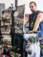 Circus Auto mechanic Erik Gunn waits for an oil change