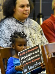 Zah'maya Chambers, 4, front, of West York Borough, and Carla Christopher, of York City, during West York Borough Council Meeting in West York Borough, Monday, Oct. 17, 2016. The council would later accept the resignation of Mayor Charles Wasko. Dawn J. Sagert photo