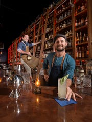 Bartenders Andrew Pope, of the Old Hickory Whiskey Bar, left, and Patrick Bolster, owner of the Union Public House, pose behind the bar at the Old Hickory Whiskey Bar in Pensacola on Monday, March 20, 2017.  Pope and Bolster are among the founders of the new Pensacola chapter of the United States Bartenders' Guild.
