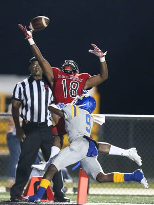 Brandon High School's Jonathan Mingo (18) goes high in the air in an attempt to catch a pass in the end zone as Tupelo High School's Nija Cole (9) defends. Brandon and Tupelo played in an MHSAA Class 6A football game on Friday, September 8, 2017 at Brandon. Photo by Keith Warren