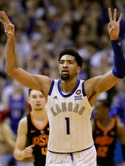 FILE - In this Feb. 9, 2019, file photo, Kansas' Dedric Lawson celebrates after making a 3-point basket during the second half of an NCAA college basketball game against Oklahoma State, in Lawrence, Kan. The University of Kansas and Adidas announced Wednesday, April 24, 2019, an extension of their contract through 2031, despite an FBI investigation centered on the footwear and apparel company that cast a negative light on the Jayhawks' athletic programs. The Jayhawks have worn Adidas gear since 2005. The original eight-year agreement was extended by six years through 2019, then another extension was put on hold last fall amid the investigation. The new deal is worth $14 million annually. (AP Photo/Charlie Riedel, File)