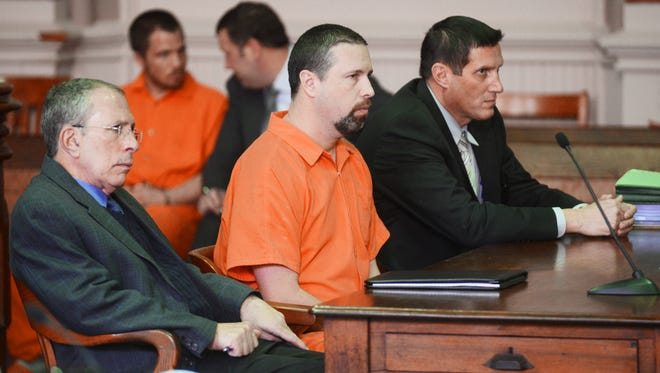 Terry Prouty sits with his attorneys, Shawn Crawmer, right, and Terry Sherman after pleading guilty to rape and bribery in Muskingum County Common Pleas Court on Monday.