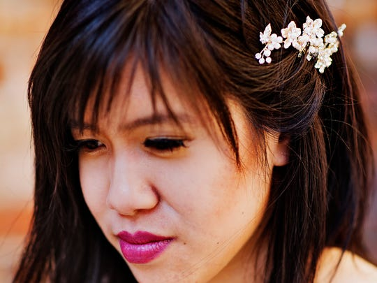 Thao Pham, 24, models a vintage hair pin from Dornink.