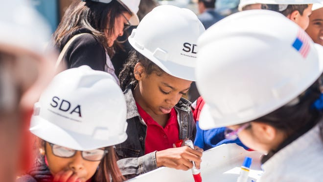 Vineland students make their mark on history during the beam signing of Lincoln Avenue Middle School on Thursday.