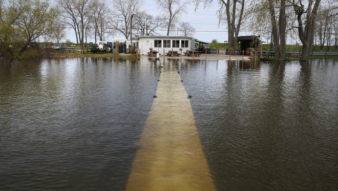 2017 file photo; Water completely covered the dock with a foot of water as Irondequoit Bay continued to rise at the Bay Side Pub, 279 Lake Road in Webster.