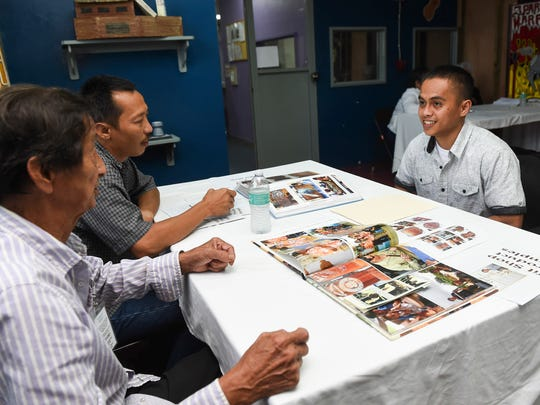 Ifit Shop owner Robert Taitano, left, together with his son and co-owner Robert Taitano, Jr., center, conducts an interview with a Guam Department of Corrections inmate under the Residential Substance Abuse Treament Program, during a job fair at GDOC on Aug. 3, 2018. Eleven company representatives attended and conducted interviews for the 24th cycle of RSAT Program participants, who are set to graduate on Aug. 17.