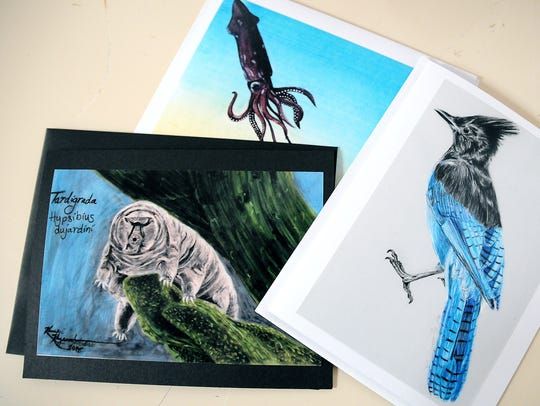 Pictured are prints of  Kami Koyamatsu's artwork in
