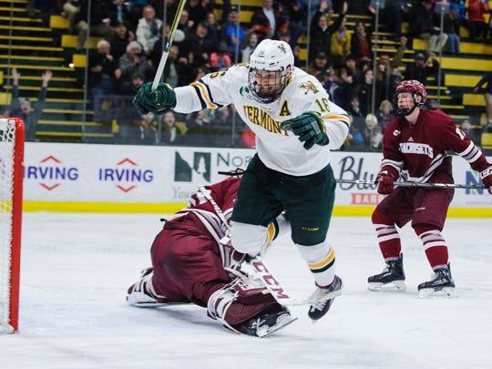 Vermont forward Derek Lodermeier (16) gets tripped