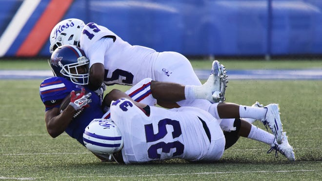 Shawn Newsome of Fremont Ross, bottom, is a defensive back on the News Herald/News-Messenger team.