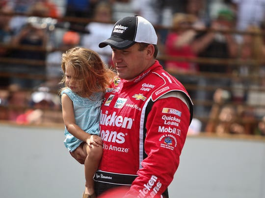 Ryan Newman (39) makes his way to kiss the bricks after winning the Brickyard 400 on Sunday, July 28, 2013, at The Indianapolis Motor Speedway in Speedway, Ind. Adam Wolffbrandt / The Star
