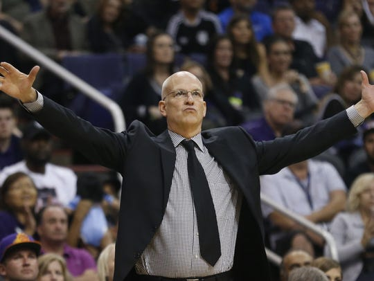 Suns interim head coach Jay Triano watches his team