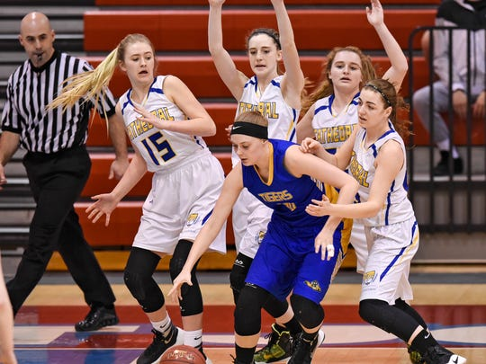 Cathedral players team up on defense during the first half of the Tuesday, March 7, Section 6-2A playoff game against Rush City at St. John's University in Collegeville