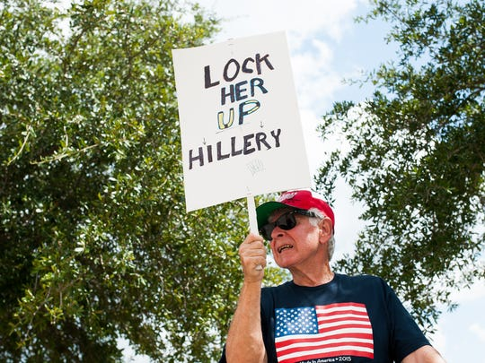 Yepram Dervahanian, 75, of Lehigh Acres, holds a sign outside a Trump rally at Germain Arena in Estero on Monday, Sept. 19, 2016.