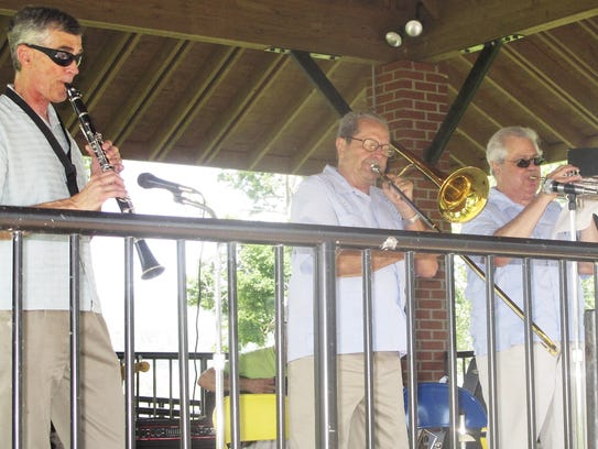 Members of Cavallaro's Dixieland Band perform during
