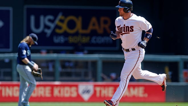 Minnesota Twins' Chris Gimenez circles the bases after hitting a three-run home run off Seattle Mariners starting pitcher Ariel Miranda in the first inning of a baseball game Thursday, June 15, 2017, in Minneapolis. (AP Photo/Jim Mone)