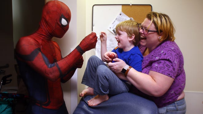 Spider-Man, Erik Bas of Pennsville, blows bubbles with 5-year-old Jax Denning of Bridgewater with the help of mom Kendra during the Superheroes' visit to patients at Goryeb Children's Hospital on the third annual Superhero Day. Aug. 31, 2017.