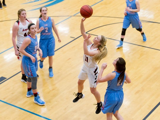 Maryville's Courtney Carruthers (11) goes for a layup