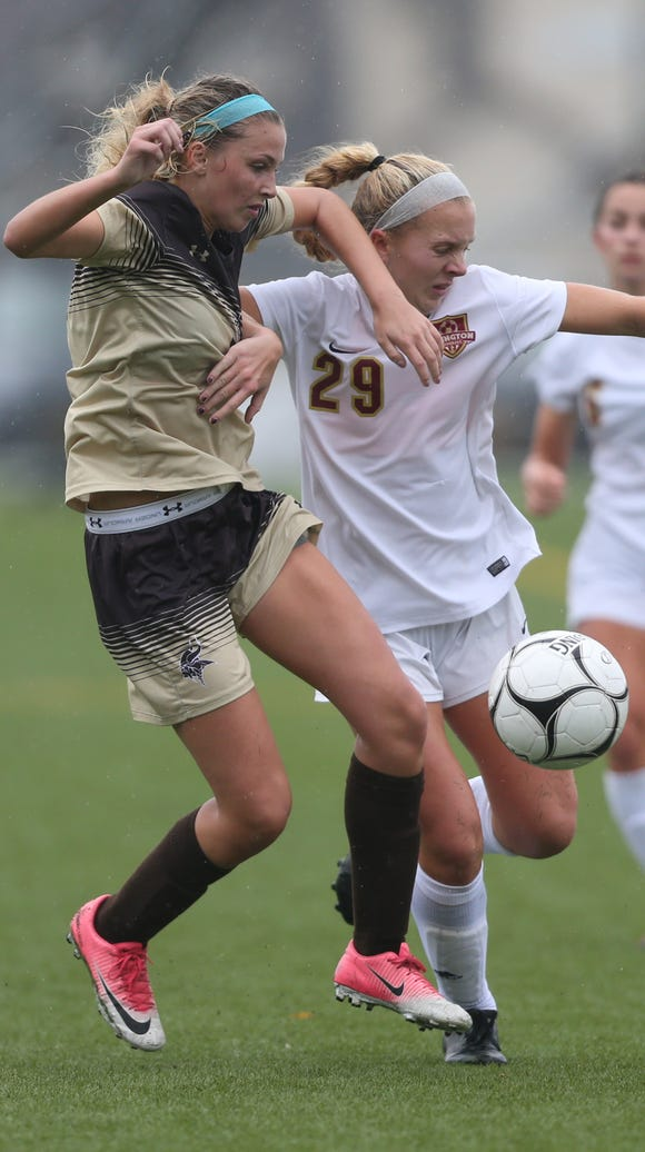 Clarkstown South's Faith Quinn (19) and Arlington's