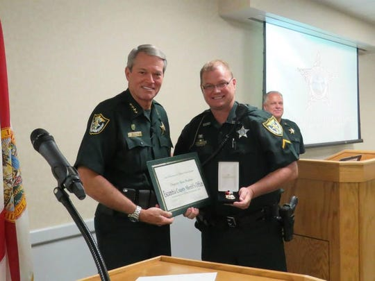 Sheriff David Morgan with ECSO Law Enforcement Officer of the Quarter, Deputy Ron Busbee