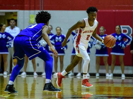 Bosse's Mekhi Lairy dribbles past Memorial's Dylan Penn on Tuesday. Bosse and the Tigers will play outside opponents in the eight-game Bosse Winter Classic on Saturday.