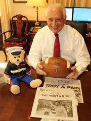Troy University Chancellor Jack Hawkins holds the game