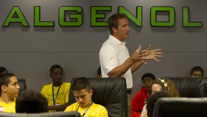 Mitch Ruzek speaks to local high school students as they tour Lee County-based Algenol Biofuels, part of an NAACP and FGCU pre-collegiate summer camp.