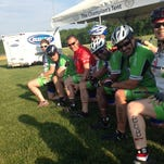Members of Shore Velocity honor Bob Maddux, their injured president, at the Tour de Cure in Easton on Saturday.