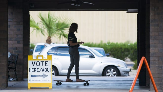 Tori Jensen, 18, rides her long board to Parkway Community Church in Phoenix to cast her ballot in Arizona's primary election on August 30 -- her first time voting.