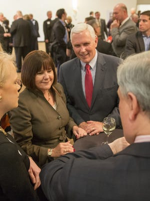 Indiana Gov. Mike Pence and his wife, Karen, visited with people at a VIP reception in Carmel organized by the Hamilton County Republican Party on April 13, 2016.