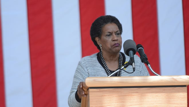 Myrlie Evers speaks at the ceremony remembering the 50th anniversary of the assassination of NAACP Field Secretary and civil rights icon Medgar Evers at Arlington National Cemetery in 2013. The events in Charlottesville, Va., on Aug. 11 and Aug. 12, 2017, has driven her to tears.