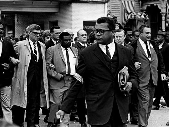 The Rev. James Lawson, center, is one of 25,000 getting ready for a silent march of mourning for the civil rights leader Martin Luther King Jr. in the streets of Memphis in 1968.