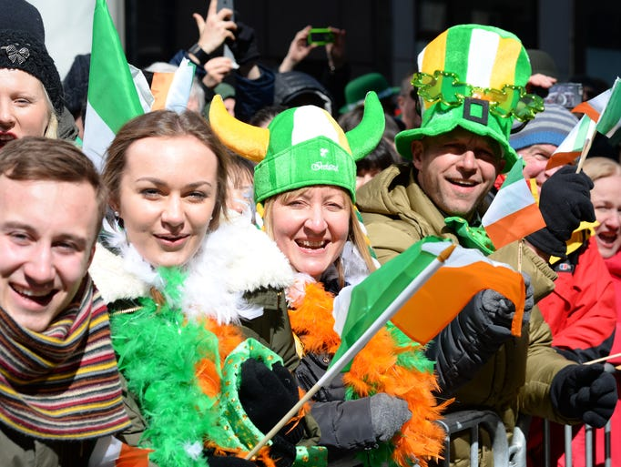Fans watch the St. Patrick's Day Parade on New York's