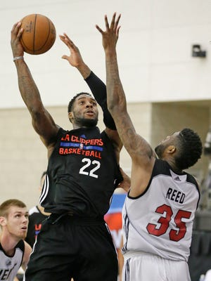 Los Angeles Clippers' Branden Dawson (22) takes a shot over Miami Heat's Willie Reed (35) during the second half of an NBA summer league basketball game, Wednesday, July 8, 2015, in Orlando, Fla.