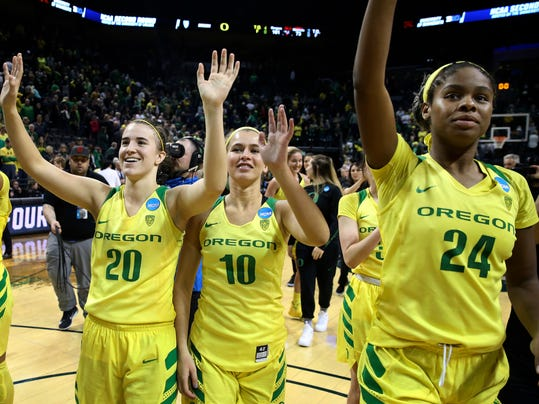 Oregon's Sabrina Ionescu, left, Lexi Bando and Ruthy Hebard, right, wave to their fans after defeating Minnesota 101-73 in the second-round game in the NCAA women's college basketball tournament in Eugene, Ore., Sunday, March 18, 2018. (AP Photo/Chris Pietsch)