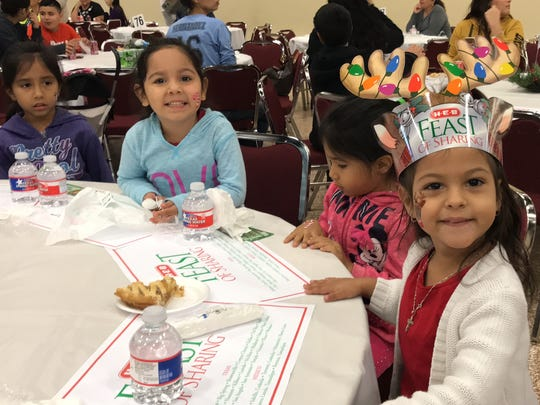 Kairi Loy, 3, smiles with her cousins at the 29th annual H-E-B Feast of Sharing Dec. 23, 2017.