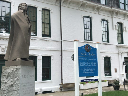 Built in 1714, Perth Amboy City Hall is the oldest public building in continuous use in the United States. Pictured at left is a statue of city namesake the Earl of Perth, James Drummond.