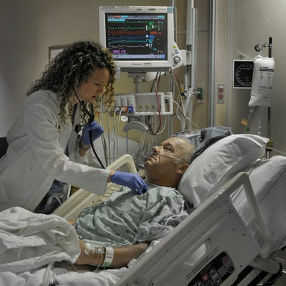 Nurse practitioner Jayme Gibson checks out patient