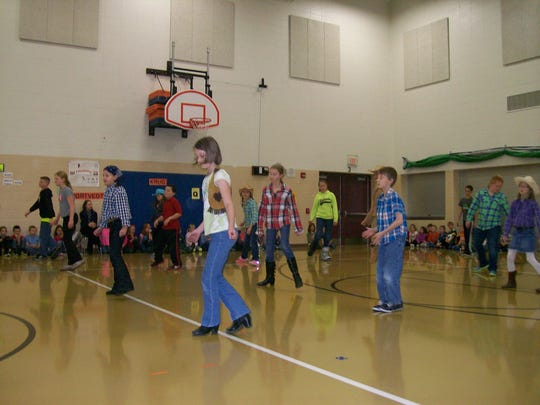 Students at Nasonville School held their first annual Harvest Dance Nov. 20 under the leadership of Physical Education teacher, Jake Rebhan. Students at all grade levels showed off the dancing skills they learned to their parents. At the end of each dance session, parents were also invited to come up, learn some new moves and dance with their children. Pictured are the fifth-grade students showing off their country line dancing skills.