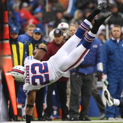 Fred Jackson is upended after a catch.