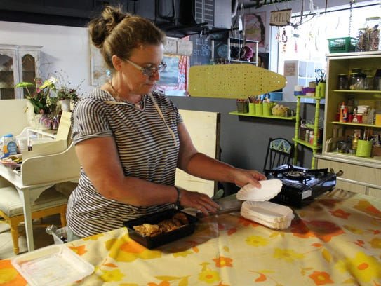 Chef Lisa Edson, dishes out fried green tomatoes at