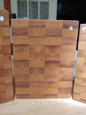A cutting board is created from long staves of old growth fir that were wine tanks in a Canandaigua Wine facility in Petersburg, Virginia, south of Richmond in the late 1980s.