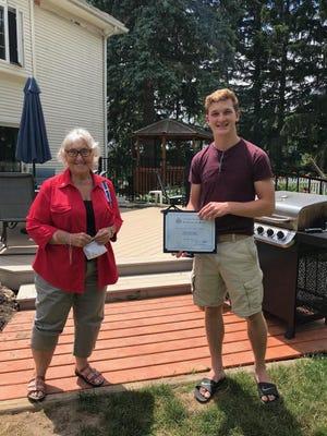 Regent Pauline Harper presents a 2019-20 Good Citizen Award to Drew Holahan, of Marion.