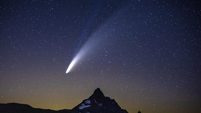 Comet Neowise appears over Mount Washington in the night sky as seen from Dee Wright Observatory on the McKenzie Pass east of Springfield late Tuesday night. [Chris Pietsch/The Register-Guard] - registerguard.com