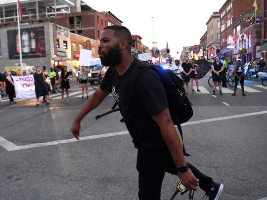 Joshua Crutchfield leads Black Lives Matter protesters at Second and Broadway Friday, July 13, 2018, in Nashville, Tenn.